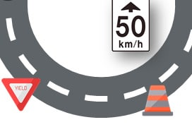 A sharp turn in the road with speed limits