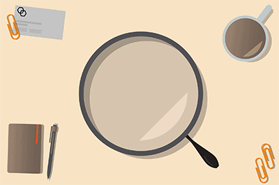 A magnifier in the middle of an office desk