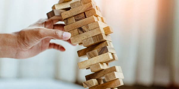 Jenga blocks fall after the wrong block is pulled.